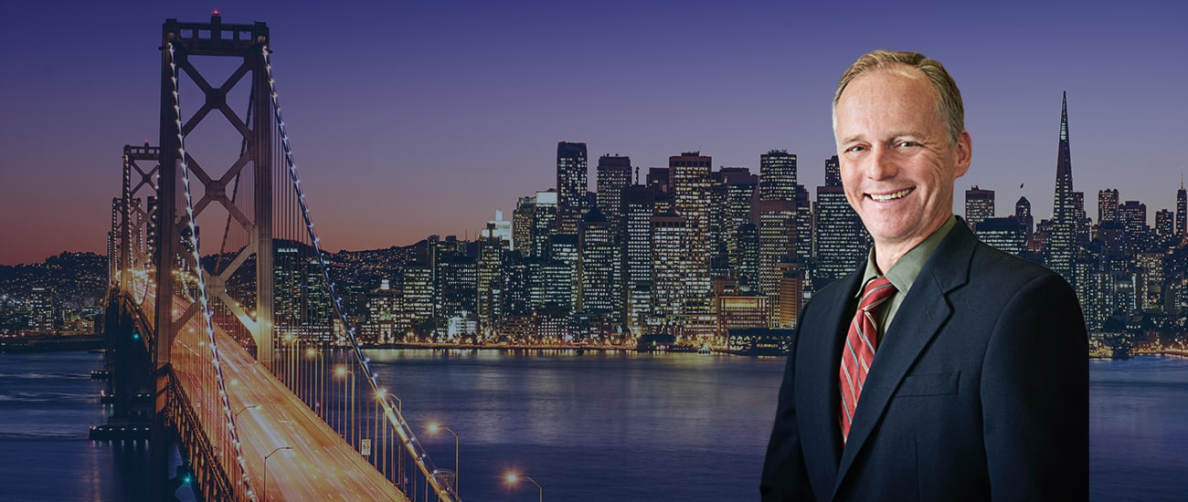 Skyline of the city of San Francisco & a picture of attorney John Stanko
